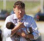 wounded Elisha in the arms of a stranger following the 911 Attack of the Pentagon